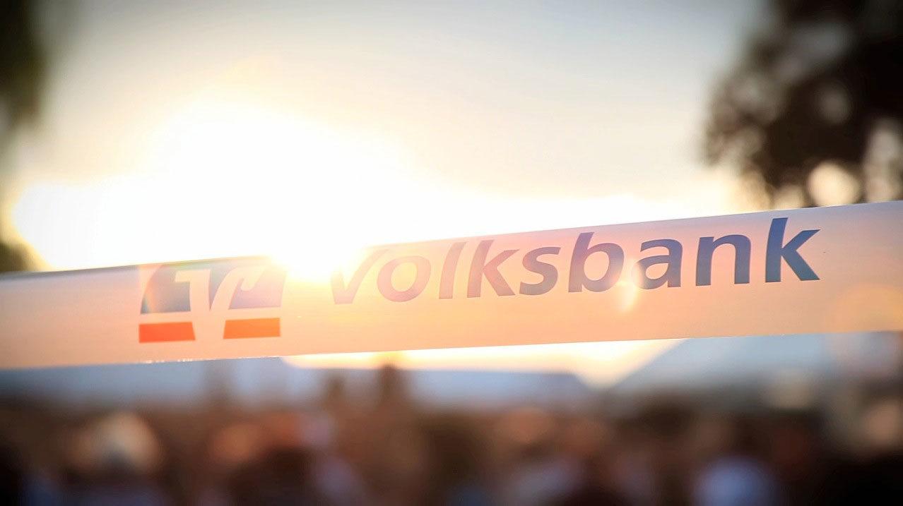 tecmotion - Imagefilm der Volksbank Halle, Banner mit Logo